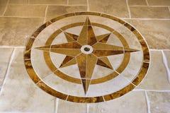 Pavimento di marmo con figura della stella. Fotografie Stock