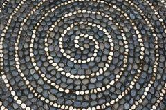 Pavimento di mosaico dei ciottoli con il modello a spirale Fotografia Stock Libera da Diritti
