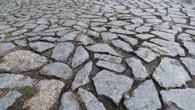 Pavimento di pietra del ciottolo sul marciapiede Fotografia Stock Libera da Diritti