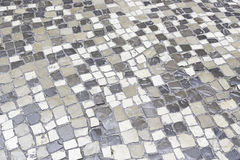 Pavimento di pietra tipico di Lisbona Fotografie Stock Libere da Diritti