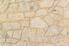 Pavimento gris viejo de las piedras del adoquín Foto de archivo