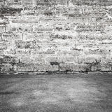 Pavimento gris viejo del muro de cemento y del asfalto Imágenes de archivo libres de regalías