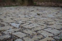 Pavimento hecho de piedras, de adoquines y de grava Fotografía de archivo libre de regalías
