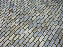 Pavimento muito velho do tijolo da rua antiga na cidade de groningen nos Países Baixos Imagem de Stock