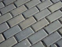 Pavimento que se enclavija gris Fotos de archivo