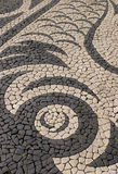 Paving 2. Portugal - Typical intricate Portuguese calcada black and white stone mosaic paving royalty free stock image