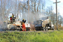 Paving the Arbutus Line. A city work crew are busy laying an asphalt surface on The Arbutus Greenway, a north-south bicycle and pedestrian corridor on November Royalty Free Stock Photo