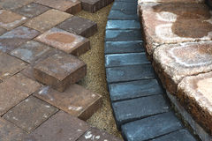 Paving Around Steps. Paving around patio steps with diffrent color tumbled pavers stock photo