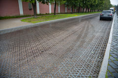 Paving blocks made of cast iron on the road in Kronstadt Stock Photography