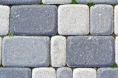 Paving blocks made of rectangular grey stones. Background. Closeup. Texture stock photography