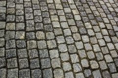 Paving cobbles stones texture. Retro street road. Background stock photos