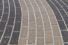Paving decorative dark and light tiles Stock Image