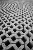 Paving grid. Newly-laid paving receding into the distance, forming a regularly-patterned background Stock Images