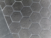 Paving hexagon brick walkway. The pattern of stone block paving Royalty Free Stock Images