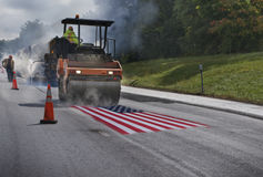 Paving over American flag Stock Image