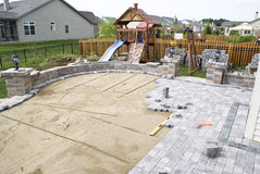 Paving the Patio. Paving patio on to levelled sand. Baxkyard Project