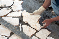 Paving a patio. With natural stones royalty free stock image