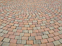 Paving pattern. Two-colored paving stone creates circular pattern on a plaza Royalty Free Stock Photography