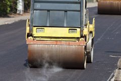 Paving Road. Shot of paving road, heavy machine on a hot asphalt stock images