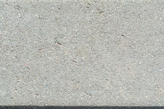 Paving slab, texture of the structure of the concrete surface with fractions of small stones Stock Image