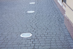 Paving slabs on the footpath Royalty Free Stock Images