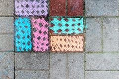 Paving slabs painted in different colors. stock images