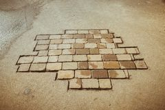 Paving slabs on the pavement. Paving slabs laid in carved grey pavement Stock Photos