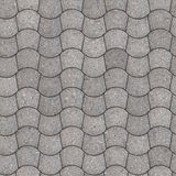 Paving Slabs. Seamless Tileable Texture. Gray Pavement - curved trapezoid. Seamless Tileable Texture Royalty Free Stock Image