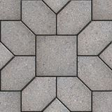 Paving Slabs. Seamless Tileable Texture. Gray Pavement in the Form of Hexagons as Petals Laid Around the Square. Seamless Tileable Texture Royalty Free Stock Photo