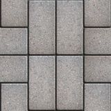 Paving Slabs. Seamless Tileable Texture. Gray Pavement of Rectangles in Pairs Laid Out Perpendicular. Seamless Tileable Texture Royalty Free Stock Photo