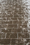 Paving in the snow. Paving in the winter snow, texture Royalty Free Stock Photo