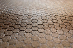 Paving Stone Circles Background. Paving stone circles in the night, after the rain in tilt shift Royalty Free Stock Images