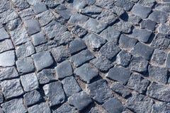 Paving stone. Dark paving stone. fragment of historic pavement pedestrian promenade stock image