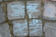 Paving stone with hand drawing decoration Royalty Free Stock Photos