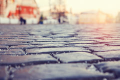 Paving stone in the old city against the background of city life Royalty Free Stock Photo