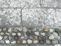 Paving stone and pebbles pavement Stock Photography