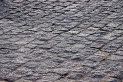 Paving stone. Stone road paved with cobblestones stock photography