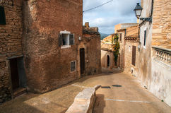 Paving stone streets in Capdepera with its traditional stone houses Stock Image