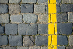 Paving Stone Texture with Yellow Line Stock Photo
