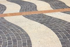 Paving stones. Decorative paving stones of different nature in Lazise, Lake Garda, Italy Royalty Free Stock Photography
