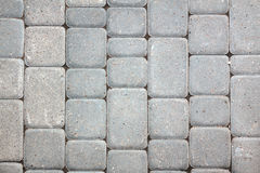 Paving stones. Background of gray paving stones royalty free stock image