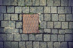 Paving stones background with metal plate Royalty Free Stock Photography