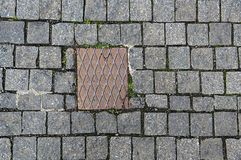 Paving stones background with metal plate Stock Photography