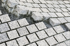 Paving stones broken and cracked Stock Image