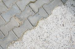 Paving Stones and Concrete Cover on a Footpath Stock Image
