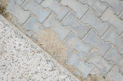 Paving Stones and Concrete Cover on a Footpath Stock Images