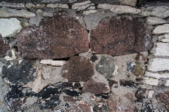 Paving stones of different sizes. In the wall Royalty Free Stock Photography