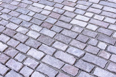 The paving stones lie diagonally, the background Royalty Free Stock Image