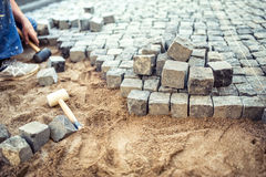 Paving stones on pavement terrace, construction details of cobblestone pavement blocks Stock Image