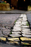 Paving stones in road Stock Images